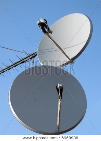 Satellite dish antenna antenna (radio antenne) for wireless mobile connections on blue sunny sky. telecommunication technology concept poster