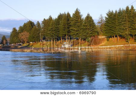 A river bank at sunset in the town of Cascade Locks Oregon. poster