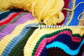 Crocheting A Colorful Striped Afghan
