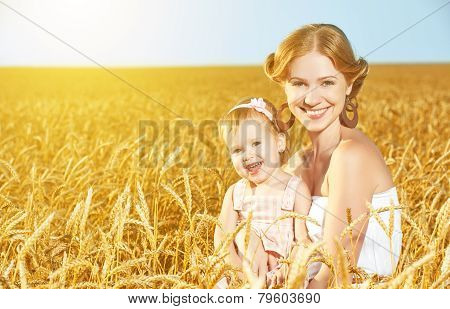 Happy Family In Summer Nature. Mother And Baby Daughter In The Wheat Field