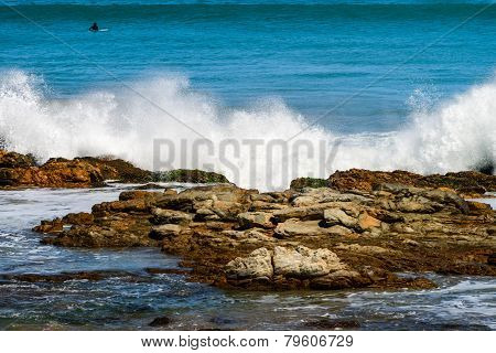 Waves crashing onto the coastal rocks