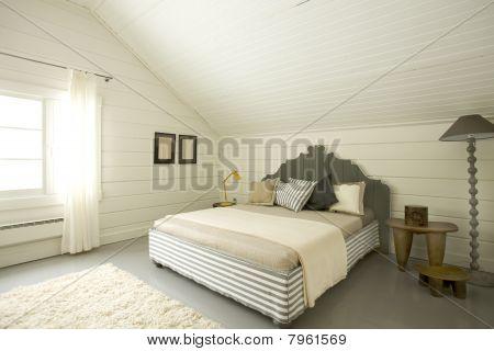 wide bedroom in the attic