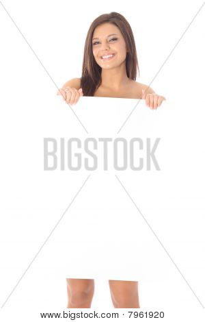 gorgeous naked model holding blank sign
