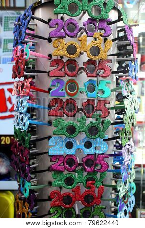NEW YORK CITY - MONDAY, DEC. 29, 2014: Novelty glasses showing 2015 New Year's Eve on sale in a shop near Times Square.