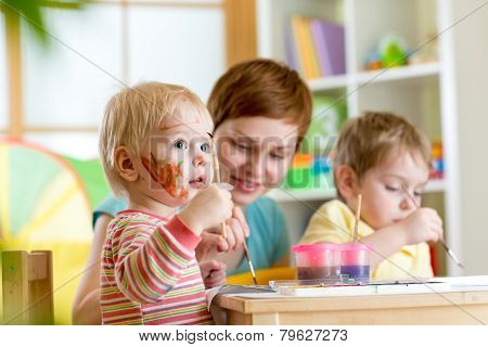 kids playing and painting
