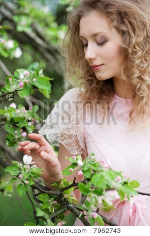 Woman Looking At Small Flower