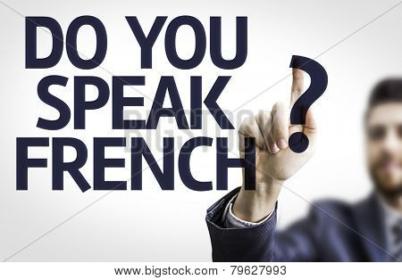 Business man pointing to transparent board with text: Do You Speak French?