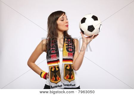 Girl Looking At The Ball In Her Hand