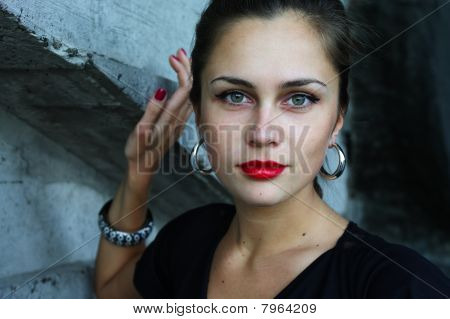 Portrait Of The Girl With Green Eyes By The Concrete Wall
