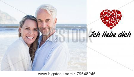 Happy couple hugging on the beach against ich liebe dich