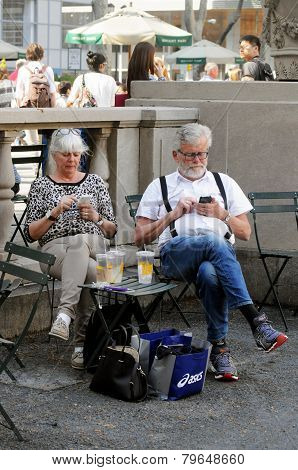 Tourists check cellphones in New York City