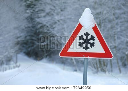traffic sign warns of snow and ice