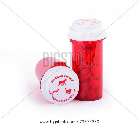 Prescription medicine for animal use in distinctive red bottles with special caps
