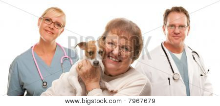 Happy Senior Woman with Dog and Veterinarian and Nurse Isolated on a White Background. poster