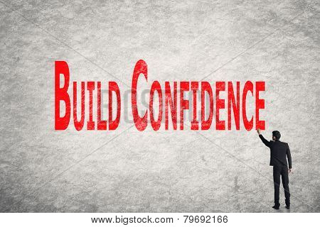Asian business man write words on wall, Build Confidence