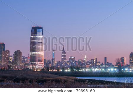 Jersey City And New York City With Manhattan Skyline Over Hudson River