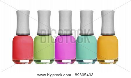 Set Of Colorful Bright Nail Polishes Isolated On White