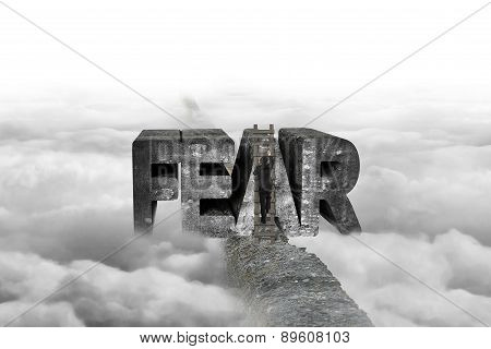 Businessman Climbing Ladder Conquering Fear Word On Ridge With Cloudscape