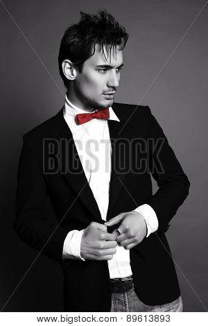 Handsome Businesslike Man With Dark Hair In Elegant Suit