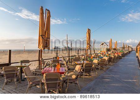 Terraces Along The Dutch Beach With A View At The Pier Of Scheveningen