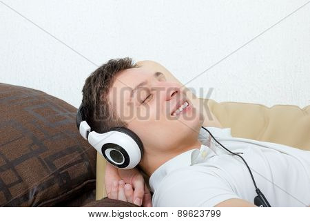 Handsome Man With Headset Listening To Music Smiling