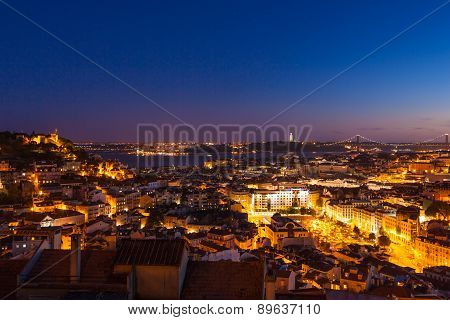 Aerial View Of Lisbon Rooftop From Senhora Do Monte Viewpoint (miradouro)  By Night In Portugal