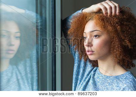 Black African American Teenage Girl Looking Through A Window
