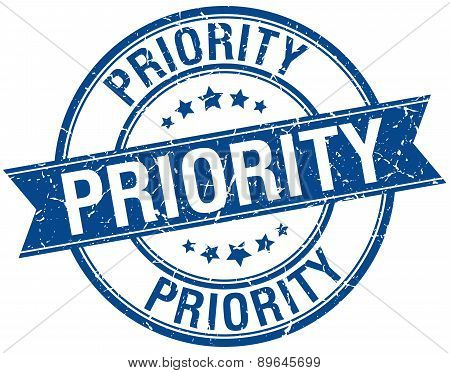 Priority Grunge Retro Blue Isolated Ribbon Stamp