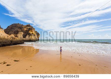 Litle Girl On The Beach