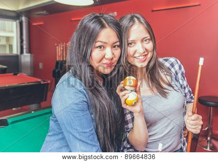 Two Girls Portrait In A Biliard Room.