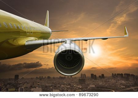 Passenger Jet Plane Flying Above Urban Scene Use For Aircraft Transportation And Traveling Business