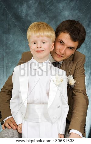 man and boy in suits