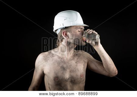 angry working in a dirty helmet