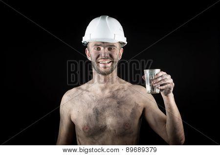 Happy dirty worker in helmet.