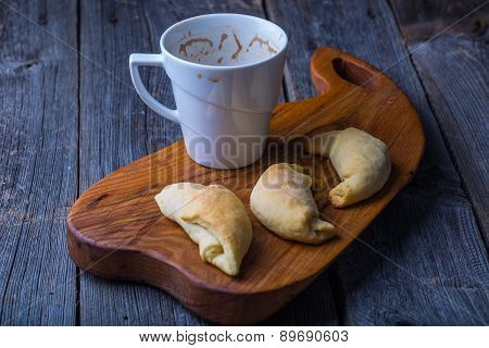 Cup Of Coffee And Homemade Yeast Croissants On A Cutting Board