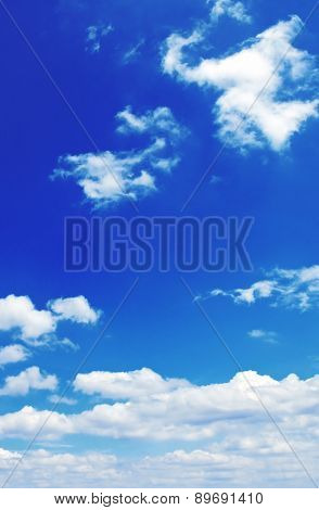 beautiful white clouds on a background of the blue sky