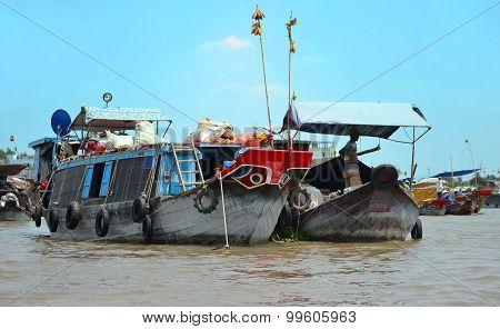 Fresh Produce Vendors Sell From Boat To Boat At The Cai Rang Floating Market, Vietnam