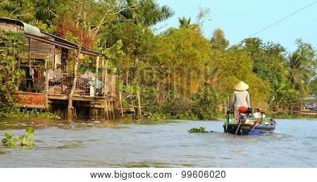 Woman Moving By Rowing Boat, The Most Common Transportation Mean Of