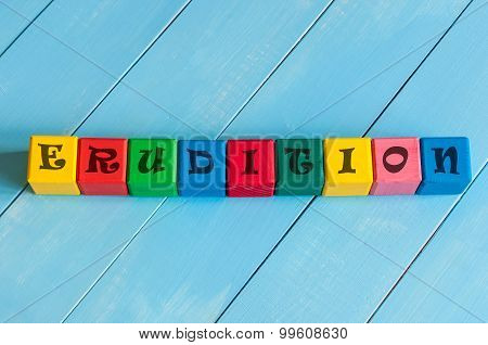 Word Erudition on children's colourful cubes or blocks - educational background for teaching.