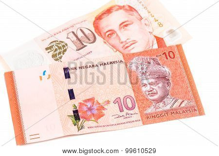 Close Up Of Singapore Dollar Currency Note Against Malaysia Ringgit