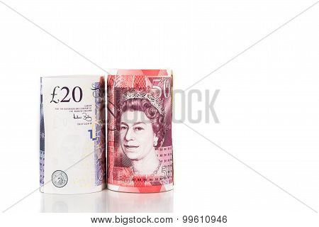Close Up Of Rolled Up British Pound Sterling Currency Note