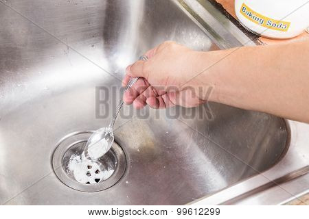 Baking Soda Poured To Unclog Drainage System At Home.