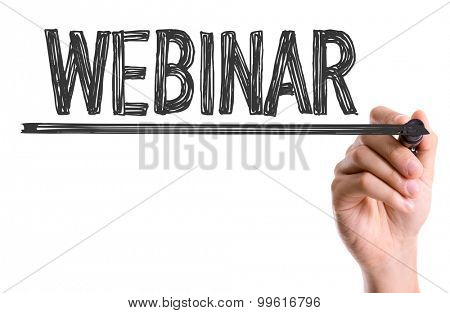 Hand with marker writing the word Webinar