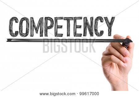 Hand with marker writing the word Competency