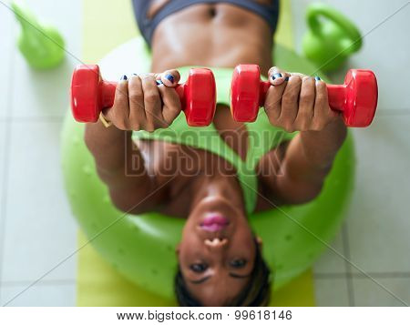 Home Fitness Black Woman Training Pectorals On Swiss Ball