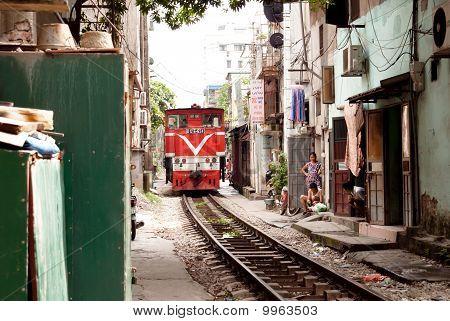 Train In A Narrow Street
