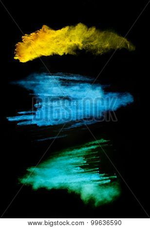 Isolated shots of abstract colored powder shape on black background