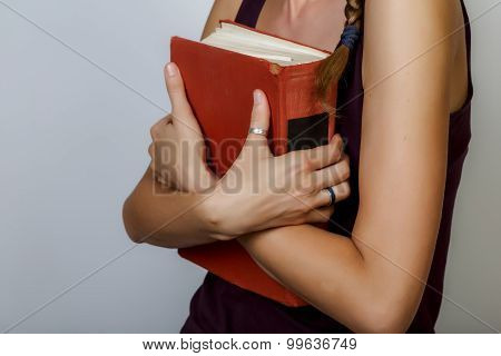 Crossed Hands Holding Book