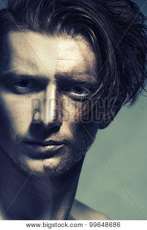 Closeup Of Man With Gold Face