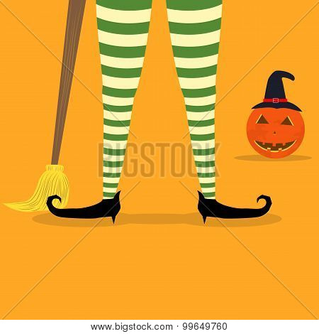Halloween witch legs and broom